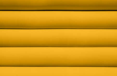 underlay: Texture of yellow inflated water mattress Stock Photo