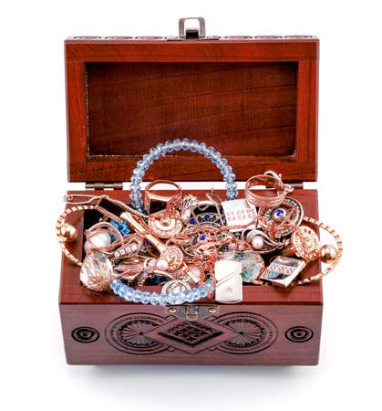 treasure: Opened redwood carved casket handmade with jewelry isolated on white Stock Photo