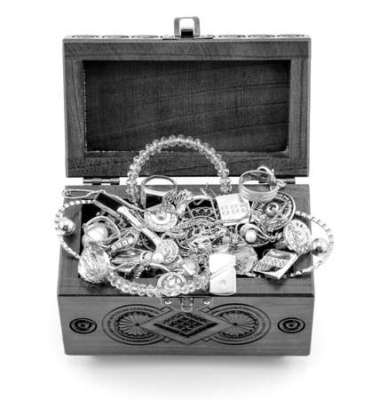 tresure: Opened wooden carved casket handmade with jewelry black and white isolated on white