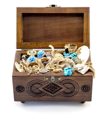 tresure: Opened ash wood carved casket handmade with jewelry isolated on white Stock Photo