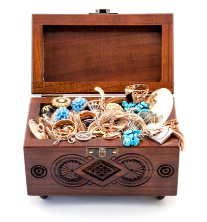 tresure: Opened oak wood carved casket handmade with jewelry isolated on white