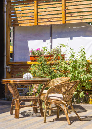 wicker bar: Wicker wooden table and chairs on terrace