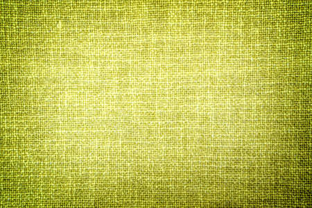 contrasted: Old bright olive color cloth texture high contrasted with vignetting effect