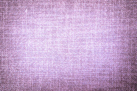 contrasted: Old violet cloth texture high contrasted with vignetting effect