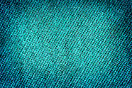contrasted: Blue fabric woven texture high contrasted with vignetting effect macro background Stock Photo