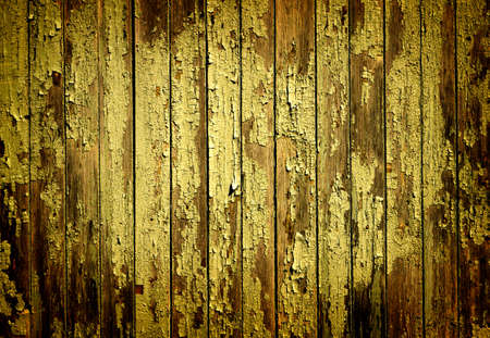 vignetting: Texture of yellow old turquoise painted wooden fence high contrasted with vignetting effect