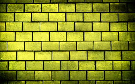 vignetting: Texture of gold decorative tiles in form of brick high contrasted with vignetting effect