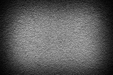 revetment: Grey revetment wall putty high contrasted with vignetting effect macro texture background