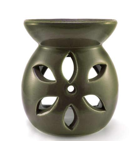aromatherapy candle: Green ceramic vase aromatherapy candle isolated on white