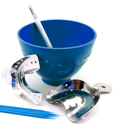 Dental metal impression trays, dental blue flask, spatula, pins isolated on white 免版税图像
