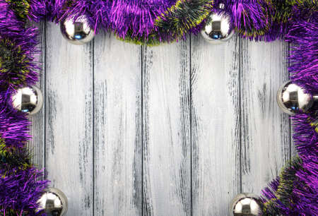 christmas backdrop: New year theme christmas tree violet and green decoration and silver balls on white retro stylized wood background