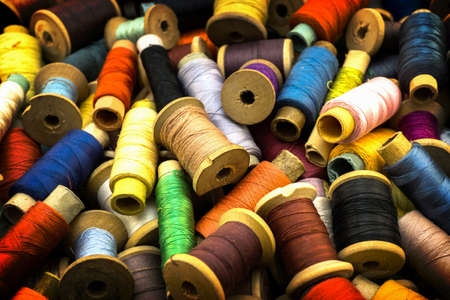 contrasted: Colored high contrasted threads for sewing background with vignetting effect Stock Photo
