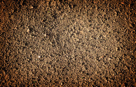 vignetting: Brown earth and gravel macro texture background high contrasted with vignetting effect