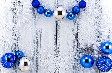 new year theme christmas tree white and silver decorations blue balls snow