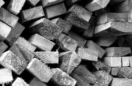 yard stick: A pile of wood bars contrasted background black and white