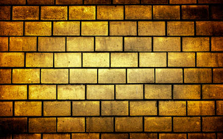 vignetting: Texture of golden decorative tiles in form of brick high contrasted with vignetting effect Stock Photo