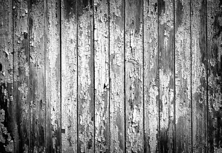 vignetting: Texture of old painted wooden fence black and white high contrasted with vignetting effect
