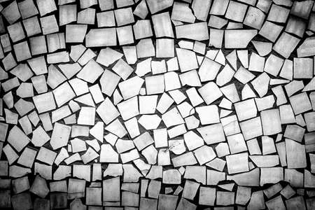 vignetting: Texture of asymmetric decorative tiles black and white high contrasted with vignetting effect