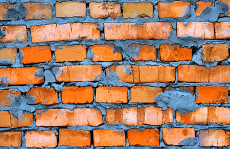 hollow wall: Fresh orange clay brickwork detailed texture background Stock Photo