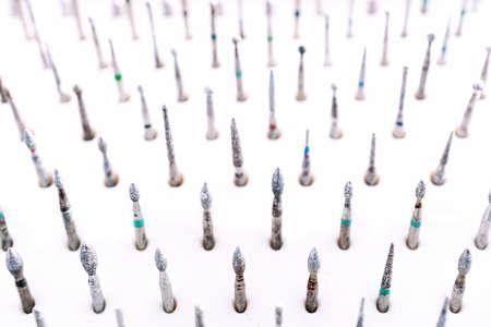 equipping: Set of dental burs macro blurred background