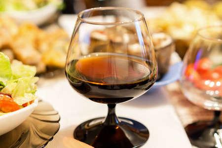 alcoholic beverage: Glass of alcoholic beverage on festive table