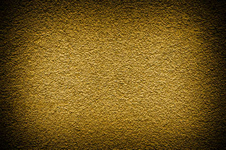 contrasted: Golden revetment wall putty high contrasted with vignetting effect macro texture background