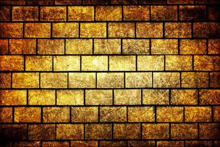 contrasted: Texture of golden decorative tiles in form of brick high contrasted with vignetting effect scratched styled Stock Photo