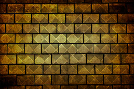 vignetting: Texture of golden decorative tiles in form of brick high contrasted with vignetting effect rhombus styled