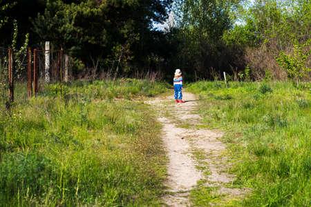 threshold: Little girl on the threshold of a dark forest