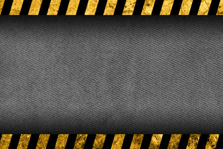 hazardous metals: Grunge dark grey background with black and yellow warning stripes