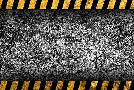 hazard stripes: Grunge dark grey background with black and yellow warning stripes