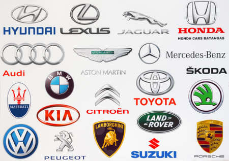 bmw: Kiev, Ukraine - September 3, 2016: Collection of popular car logos printed on white paper: Hyundai, Lexus, Honda, Jaguar, Volkswagen, Audi, Lamborghini, Skoda, Porsche, KIA, Audi, BMW and other