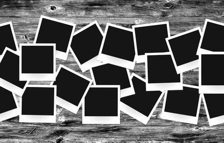 blank photo: Photo frames pack on old painted vintage wooden background retro black and white