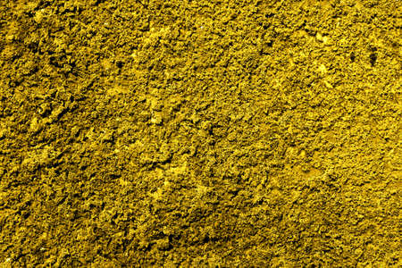 revetment: Golden revetment wall putty macro texture background