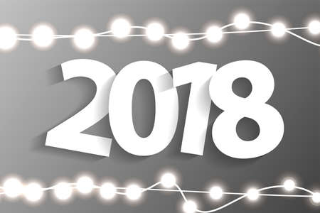 New Year 2018 concept with paper cuted white numbers on realistic Christmas lights decorations on grey background. For greeting cards. Vector illustration