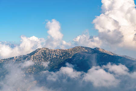 Beautiful mountains aerial landscape view. Mountain peak of rocks covered by clouds and fog. Mountain chain. Highest mountains in world. High resolution photo