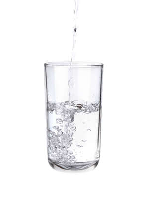Pouring water into a separate glass on a white background. Clean drinking water concept