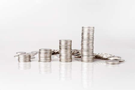 Silver coins piled on the white background Money saving ideas Zdjęcie Seryjne