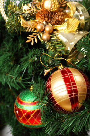 Detail of the Christmas decoration painted in red and gold, on the Christmas tree