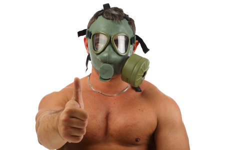 protective: Man wearing gas mask showing ok sign