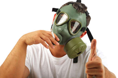 Man wearing gas mask showing ok sign, smoking photo