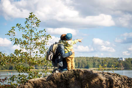 3 year old: Young father is hiking with 3 year old son