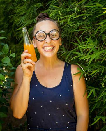 nerd girl: nerd girl with a bottle of juice Stock Photo