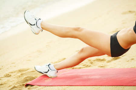 strong women: Beautiful woman is doing exercises on the shore