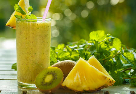 Smoothies of kiwi and pineapple on the table Stock Photo