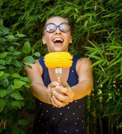 nerd girl: nerd girl with corn Stock Photo