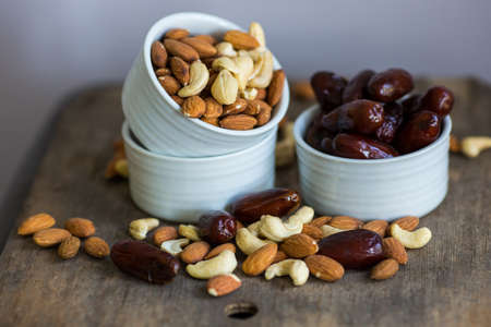 food allergy: An assortment of healthy nuts in a bowl : almond, cashew, dates and hazelnut