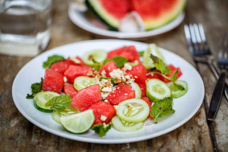 cucumbers: Watermelon salad with cucumbers Stock Photo