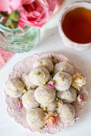 balls decorated: Homemade coconut balls decorated with little pink flowers