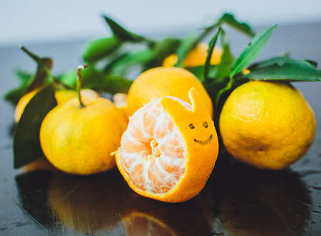 cochlea: Tangerines with leaves on a wooden table. shaped cochlea